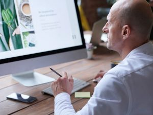 Web designer checking a desktop